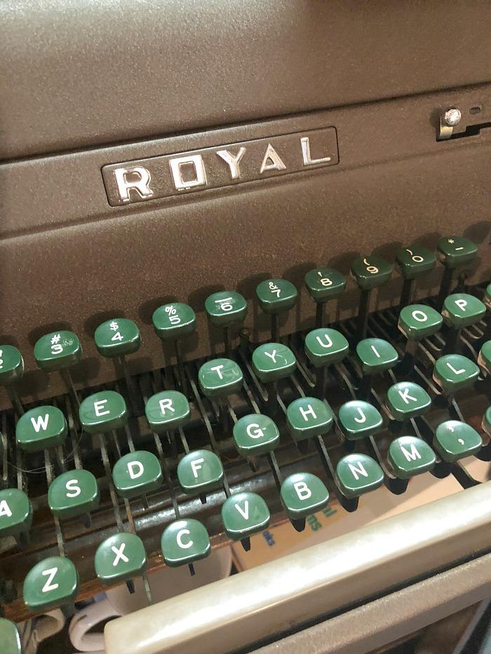 old typewriter with green keys